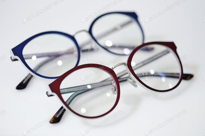 Modern fashionable spectacles on white background