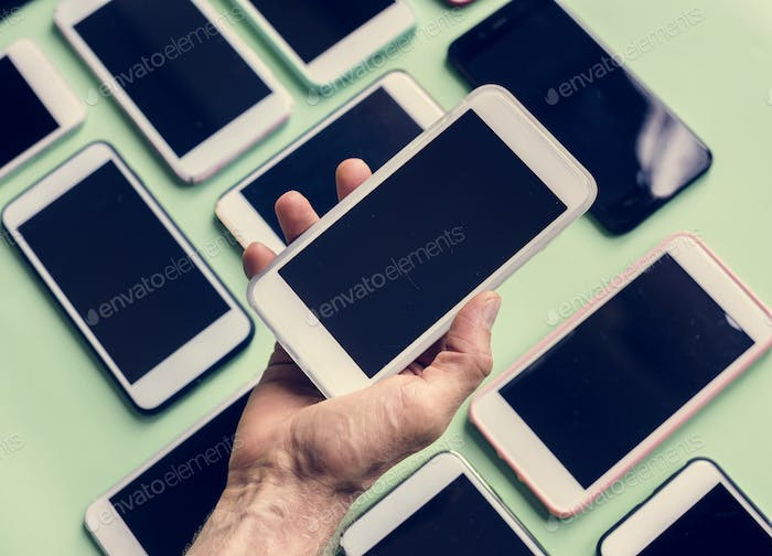 Hand holding smartphone with smartphone on background