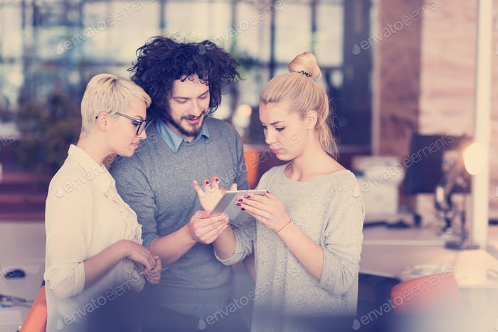 group of Business People Working With Tablet in startup office