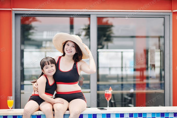 Mother and daughter in swimsuits