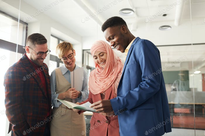 Diverse Business Team Enjoying Work in Office
