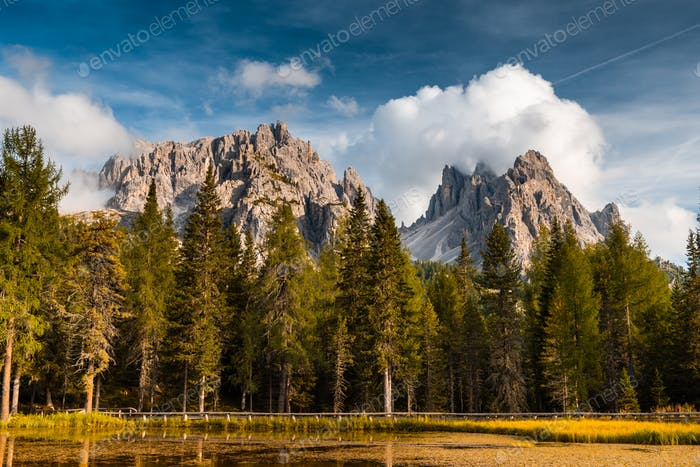 Colorful Autumn Season in Italian Dolomites Mountains at Lake An