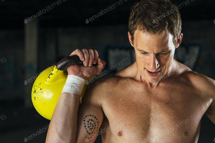 Strong man holding dumbbell in hand
