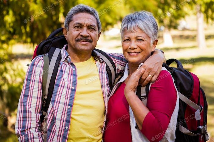 Portrait of hiker couple embracing