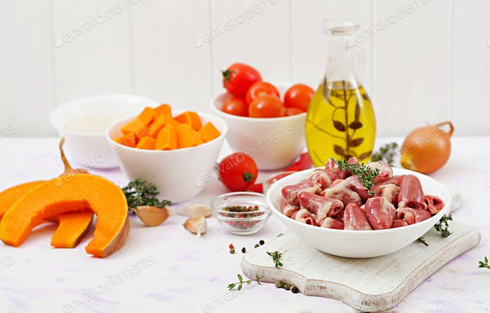 Ingredients for cooking chicken hearts with pumpkin and tomatoes in tomato sauce.