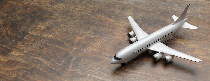 Flugzeugmodell auf Holzboden, Banner. 3D Illustration