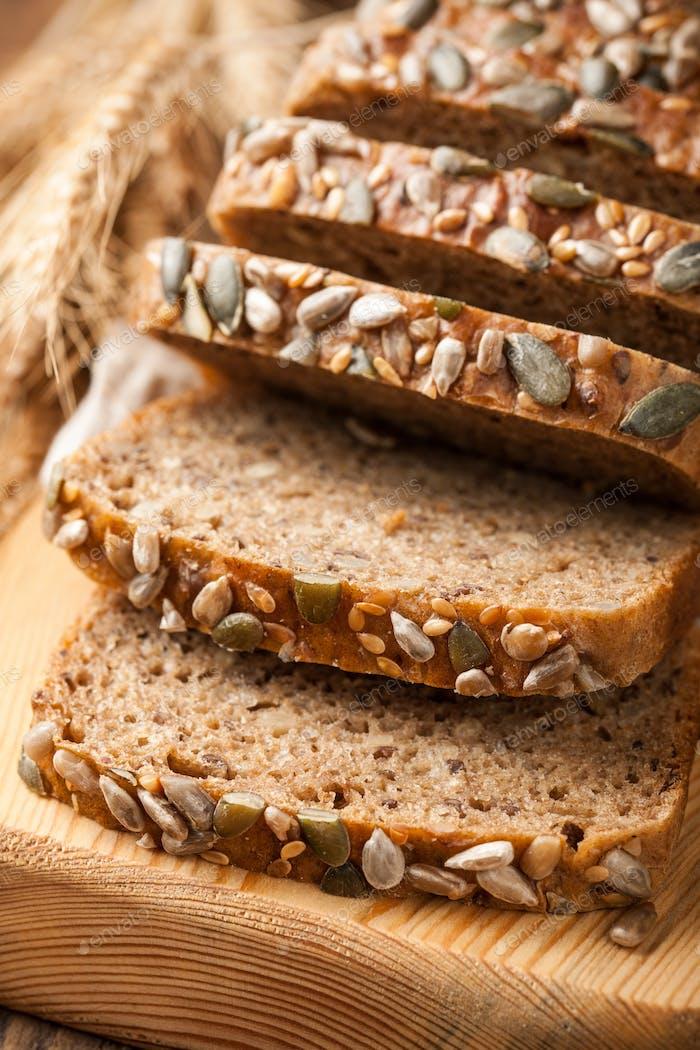 Rye grain bread on wooden cutting board