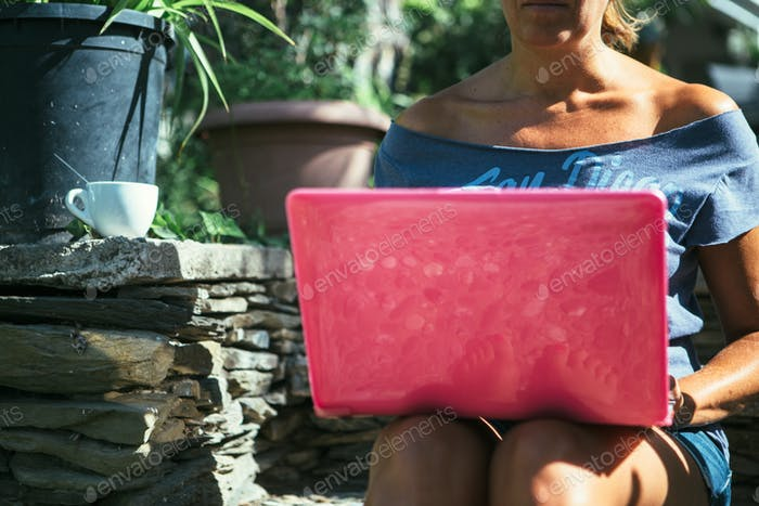 Unrecognizable woman surfing�laptop