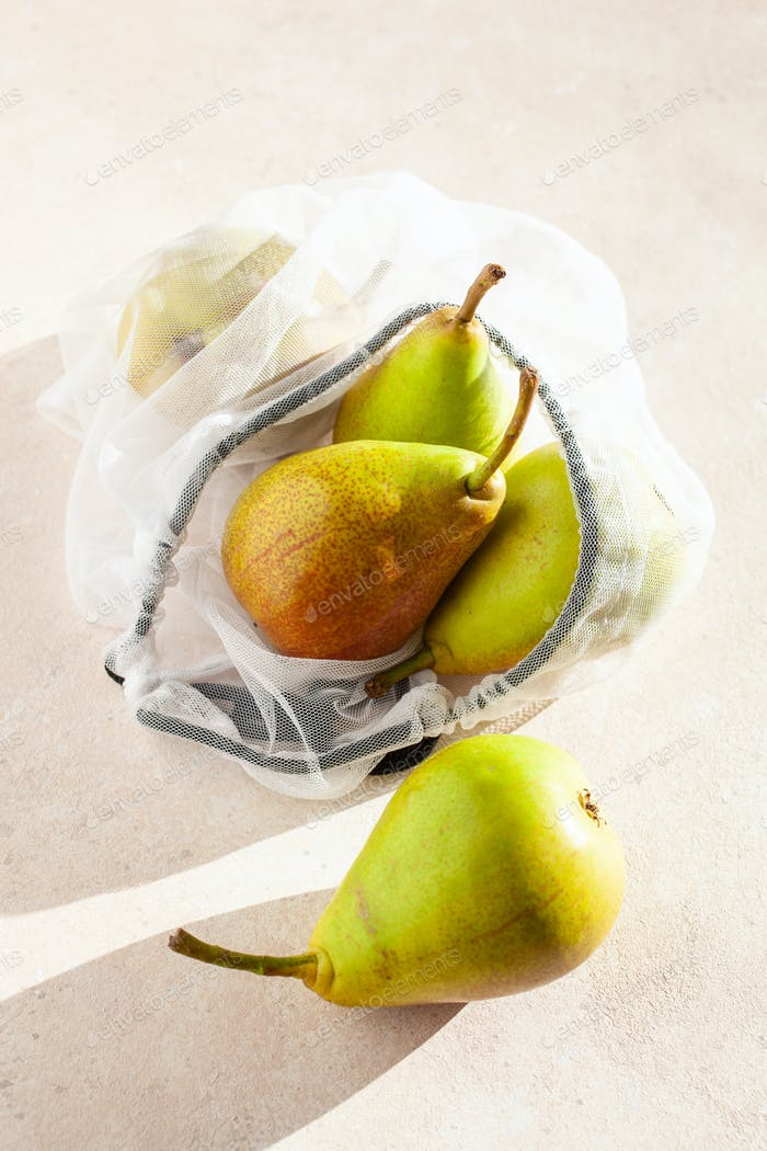 pears fruits in reusable mesh nylon bag, plastic free zero waste concept