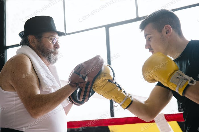 Boxer and trainer learning to punch