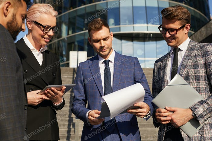 People reading business contract