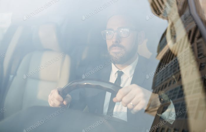 Businessman driving the car