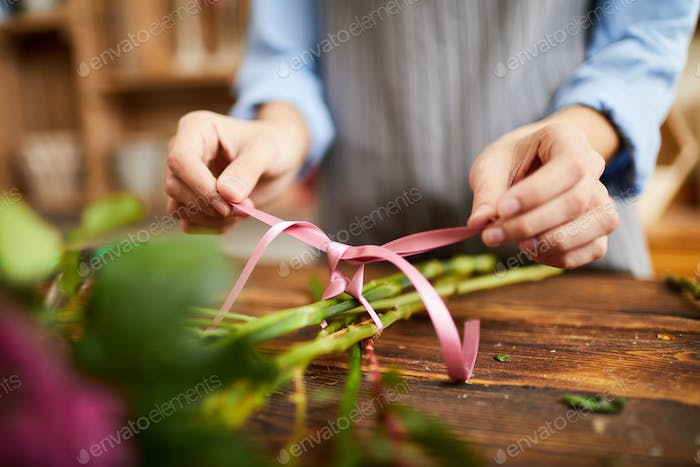 Florist Tying Bouquet Closeup
