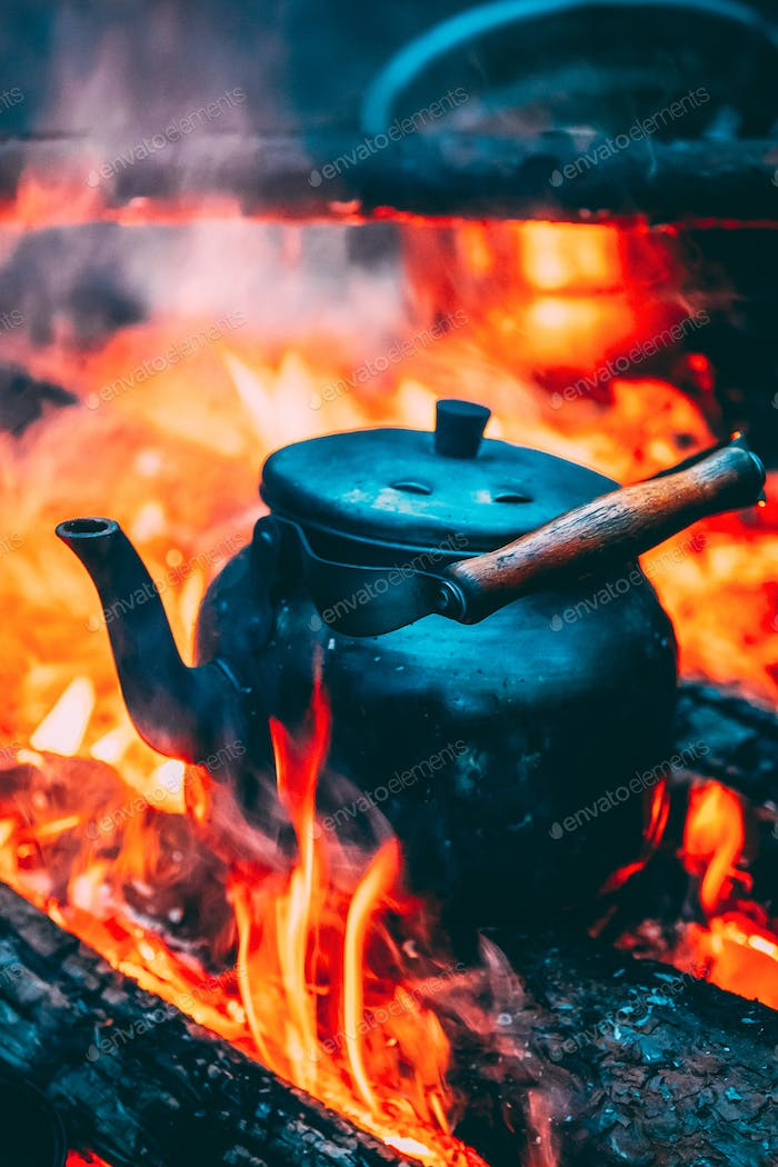 Thumbnail for Old Retro Iron Camp Kettle Boiling Water On A Fire In Forest. Br