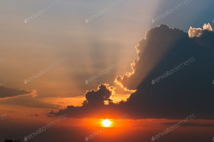 beautiful sunset with rays of the sun