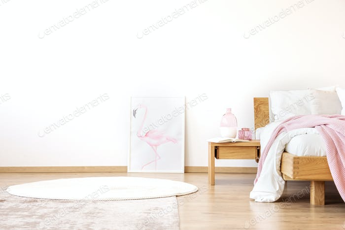 White bedroom with poster