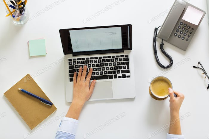 businesswoman with laptop and coffee at office