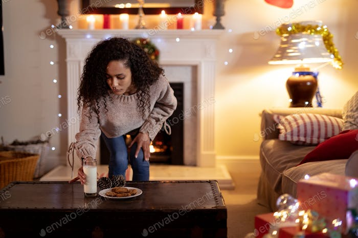 Woman at home at Christmas time