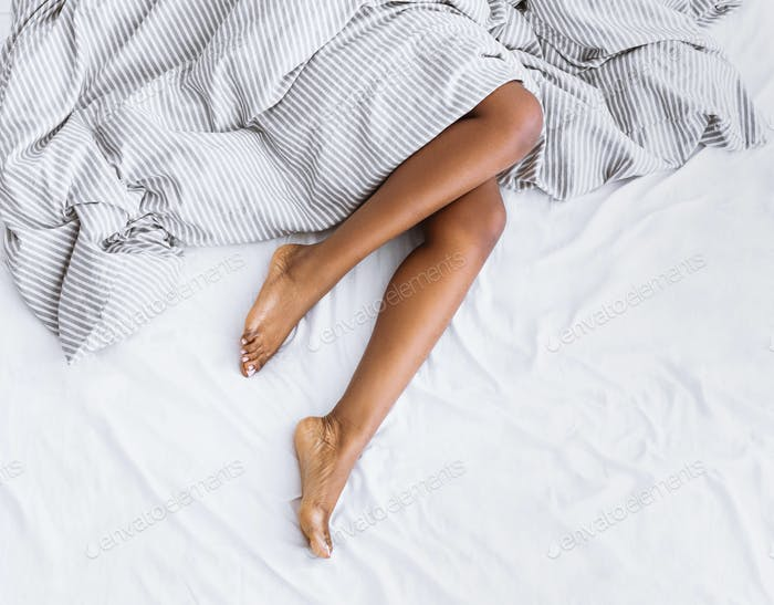 Beautiful skin and personal care. Feet african american girl with blanket