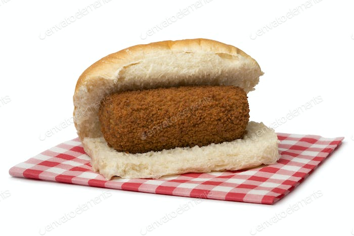 Traditional white bun with a Dutch kroket, called broodje kroket