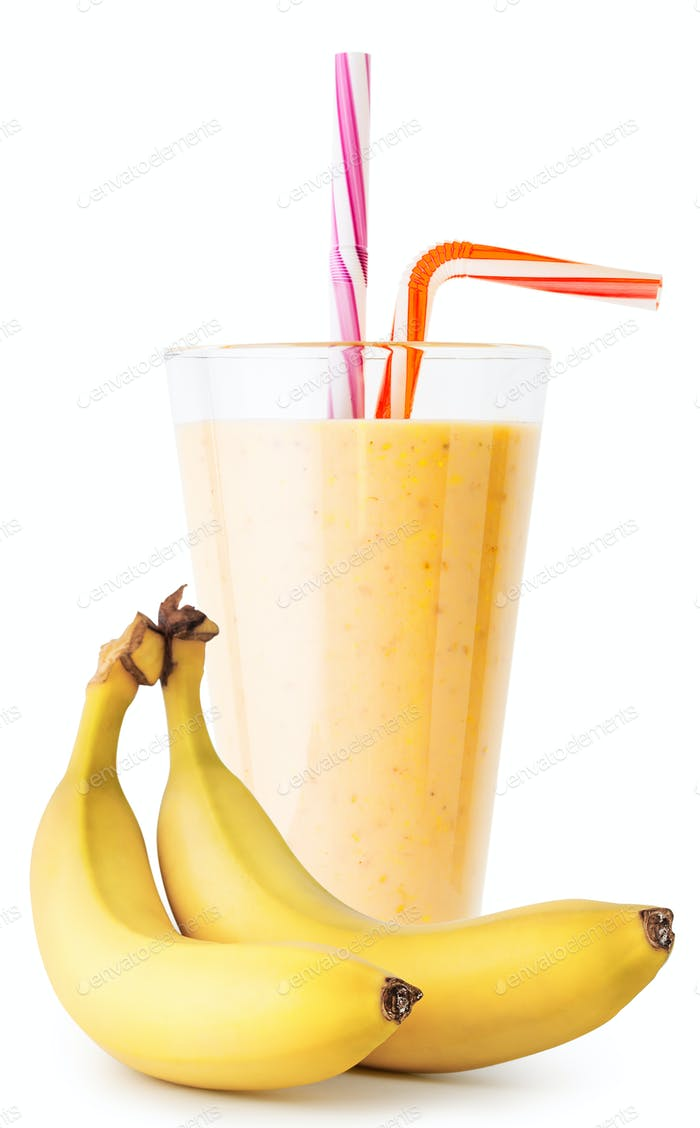 Banana smoothie or yogurt in glass with bananas