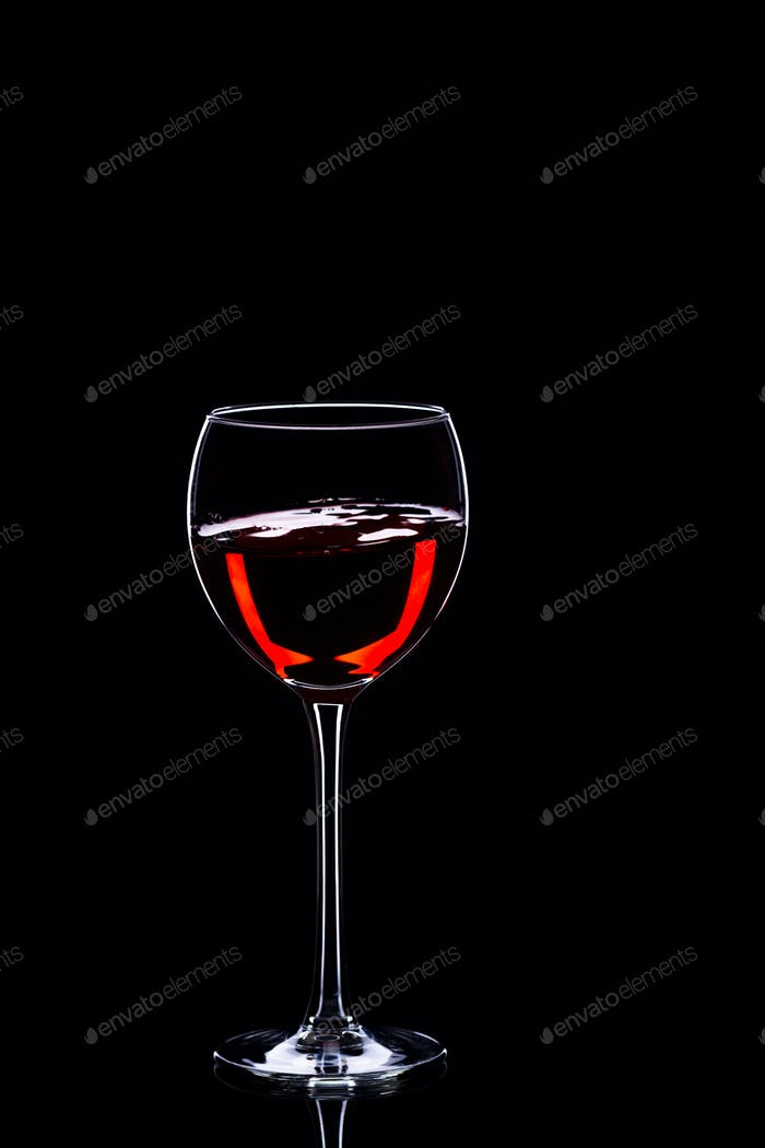 Wine glasses with wine bottle on a black background, minimalism, silhouette