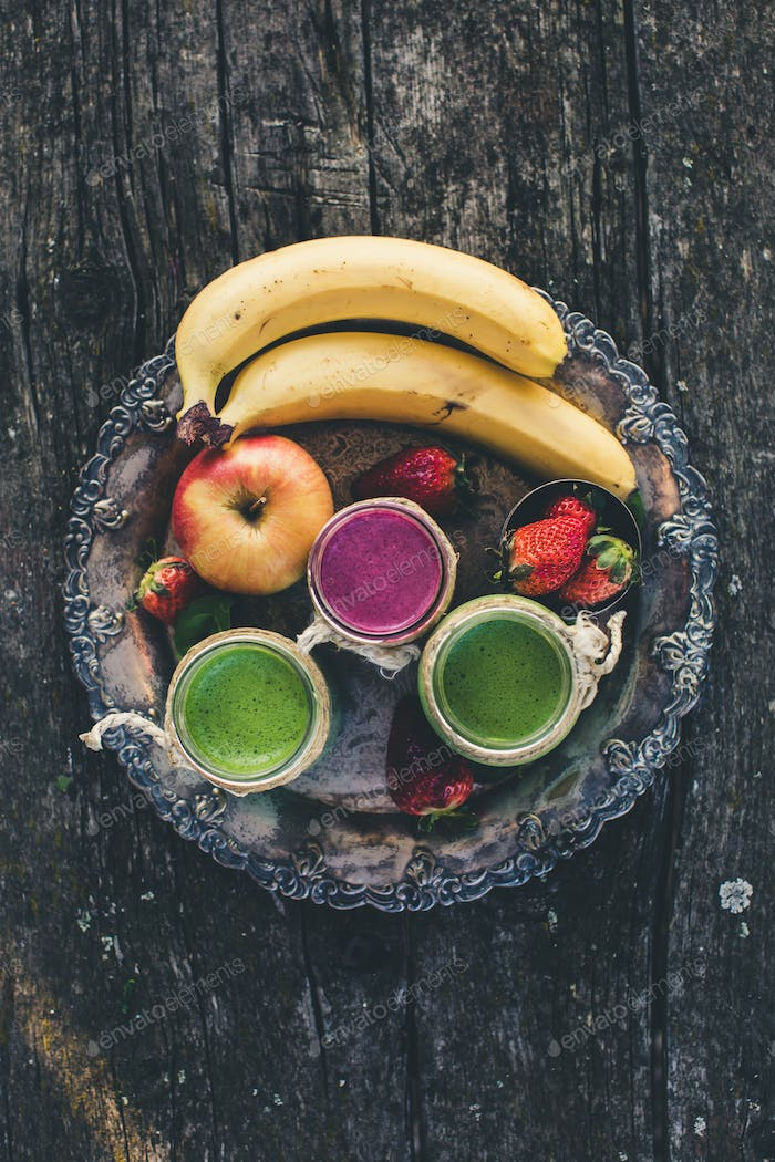 Fresh smoothies on rustic saucer. On top perspective.