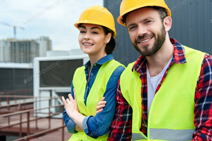 professional engineers in hardhats and safety vests on roof