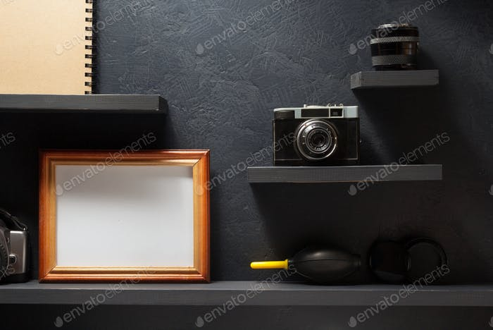 old camera and picture at shelf