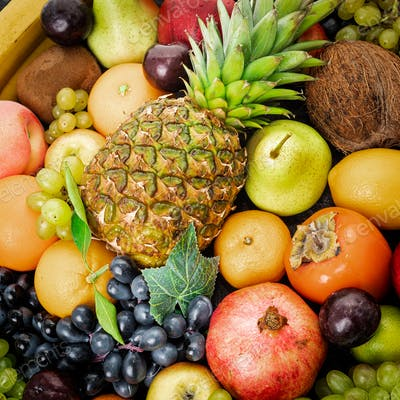 Assortment of healthy raw fruits. Mixed fruits.