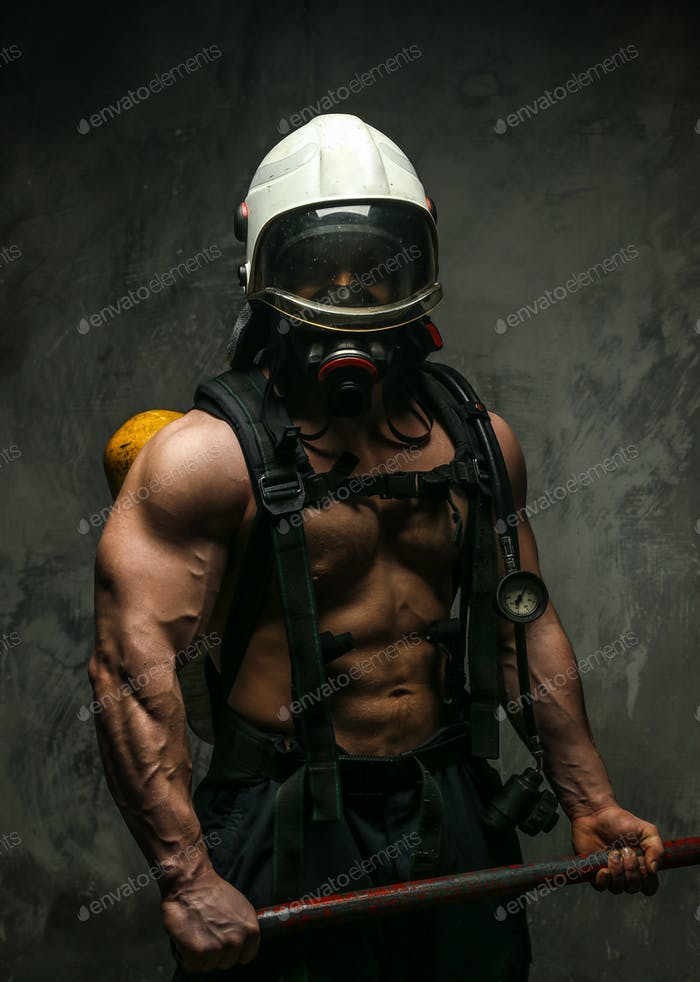 Muscular firefighter with axe