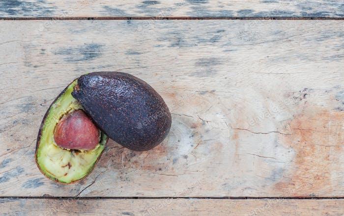 Avocado is rotten on wooden