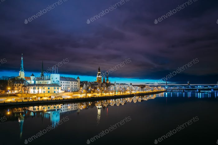 Riga, Latvia. Cityscape In Evening Dusk Time. Night View Of Cast