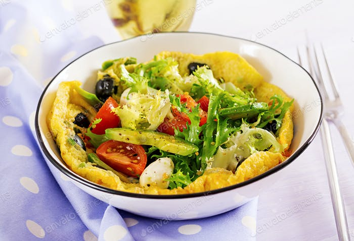 Omelet with fresh tomatoes, black olive, avocado and mozzarella cheese