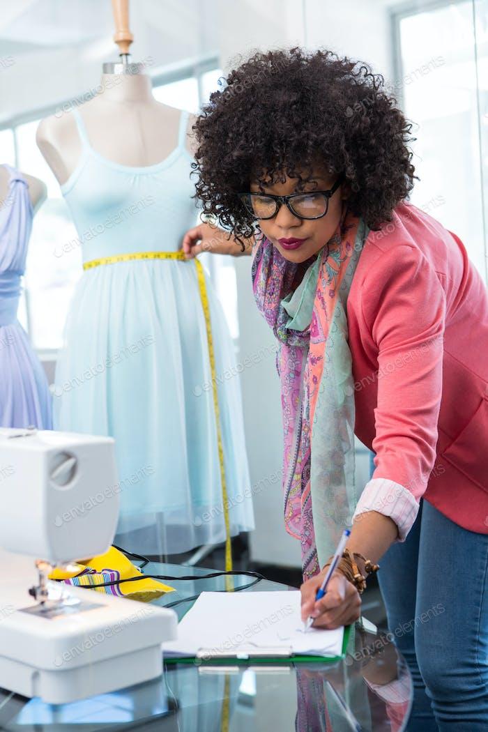 Attractive female fashion designer at work