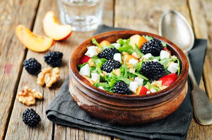 Arugula peach blackberry goat cheese salad