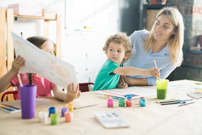 Children painting with mother