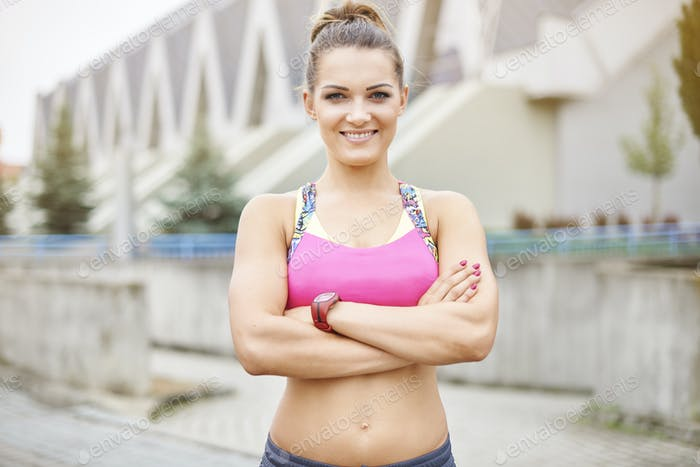 Portrait of fitness trainer in front of the gym