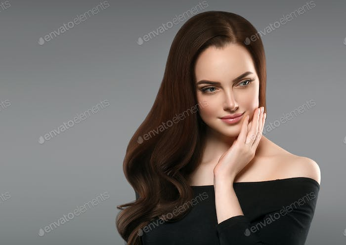Brunette with perfect hair. Woman beautiful portrait with healthy long hairstyle curly and perfect.