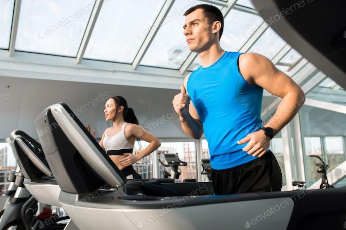 Clients Running on Treadmills
