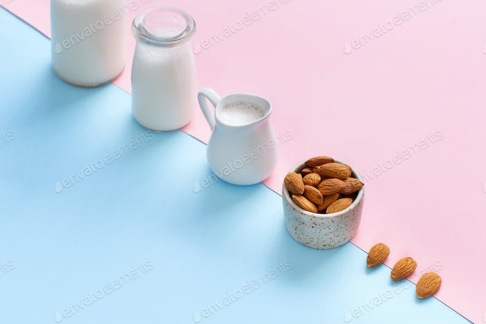 Vegan almond milk on a pink and blue background