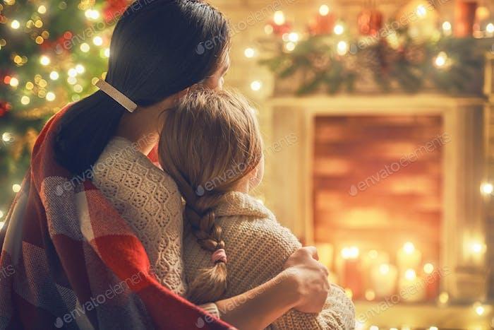 Mom and daughter near Christmas tree