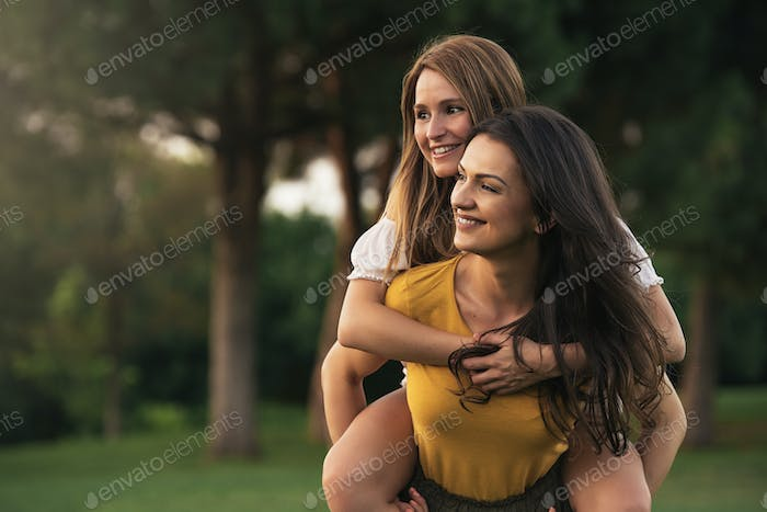 Beautiful women having fun in the park.