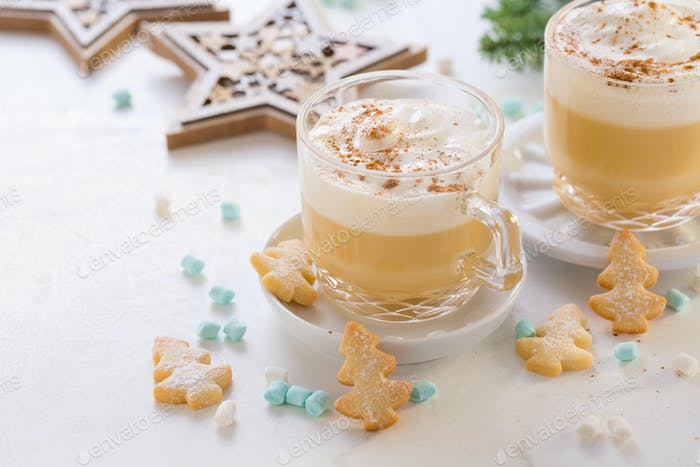 Eggnog with cinnamon and nutmeg  with small tree cookies for Christmas and winter holidays