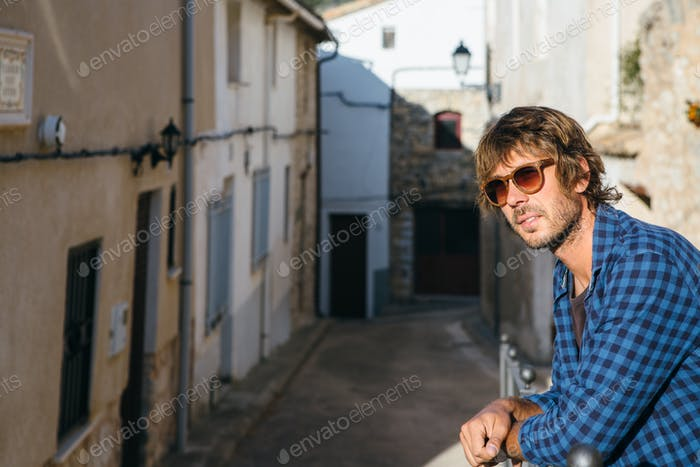 Young stylish male in sunglasses posing