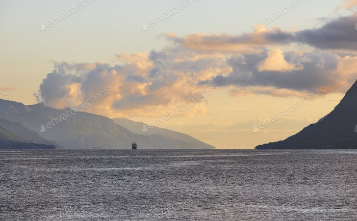 Norwegian fjord sunset landscape with cruise. Tourism Norway. Travel background