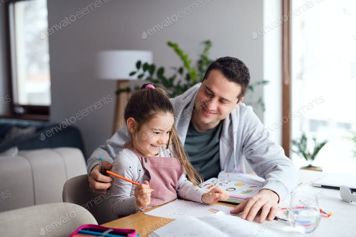 Father helping daugther with homework indoors at home, distance learning