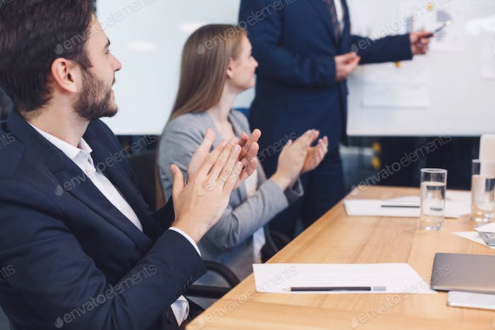 Businessman applauding to reporter after listening presentation