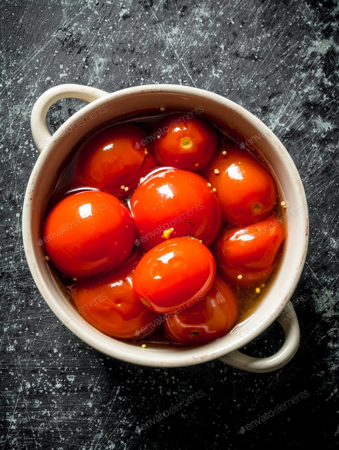 Preserved tomatoes and bowl.