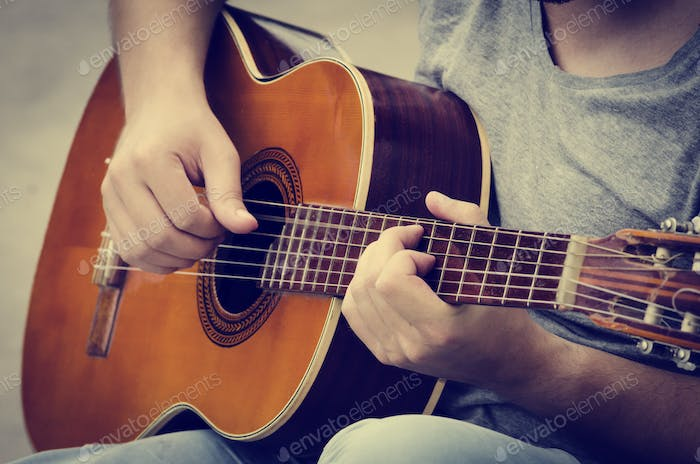 Man plays the guitar